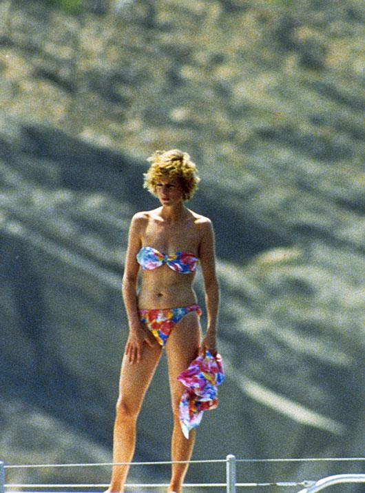 A royal knockout: The late Princess Diana looked sensational in a brightly-coloured patterned bikini during a holiday to Majorca, Spain in 1988.