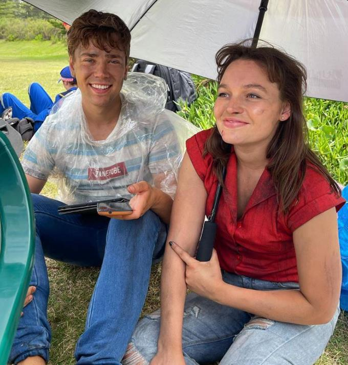 Courtney Miller and Lukas Radovich keep out of the rain.