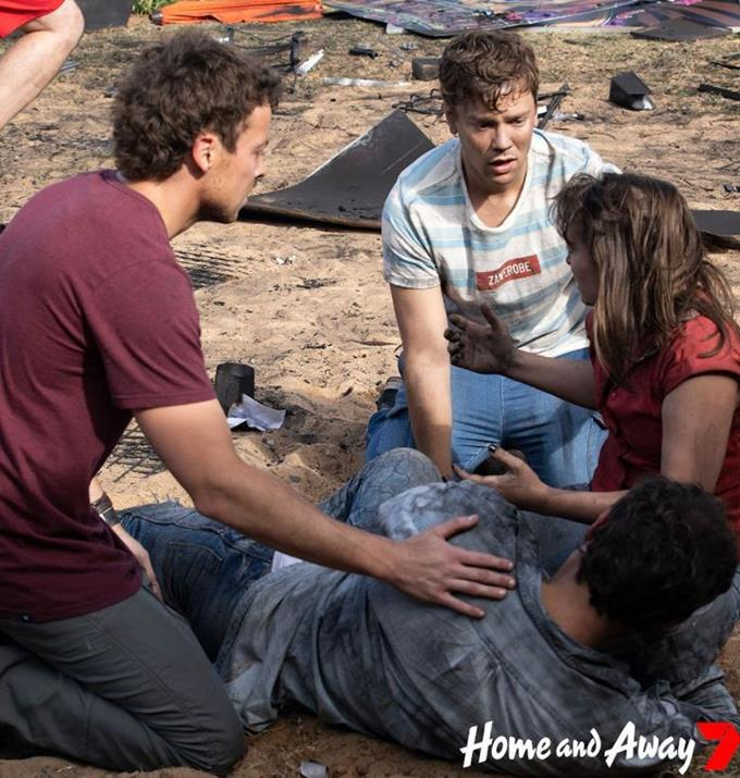The actors look in shock after the blast.