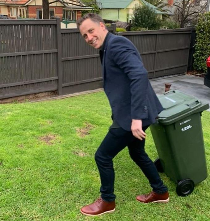 """Carrie proudly posted this picture of her man looking dapper while taking out the rubbish.  <br><br> She captioned the post, """"Love a man who gets dressed up to put the bins out 🤣❤️."""""""