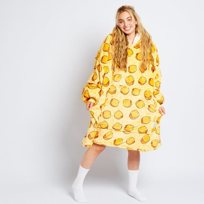 """Did someone say Garlic Bread? We'll take a slice *and* this Oodie for $109 please and thanks. **[Buy it online here](https://theoodie.com/products/garlic-bread-oodie target=""""_blank"""" rel=""""nofollow"""")**"""