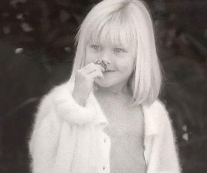 Nature lover: a young Jaimi smells a flower.