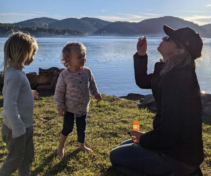 Penny blowing bubbles with Jack and Neve.