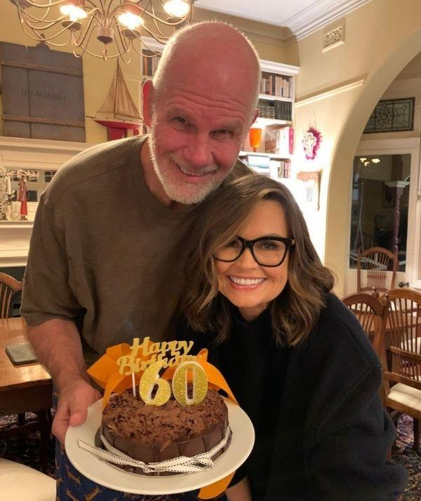 """**Lisa Wilkinson**  <br><br> Lisa made the best out of a sticky situation by celebrating her husband Peter Fitzsimons 60th birthday with big smiles on their faces. <br><br> Lisa captioned the post dedicated to her husband, """"A very happy birthday to the big fella @peter_fitzsimons who packs more into a day than I can in a year.Not quite the big celebration we were planning, but hey, life in lockdown… 🎂🎉❤️ xxx."""""""