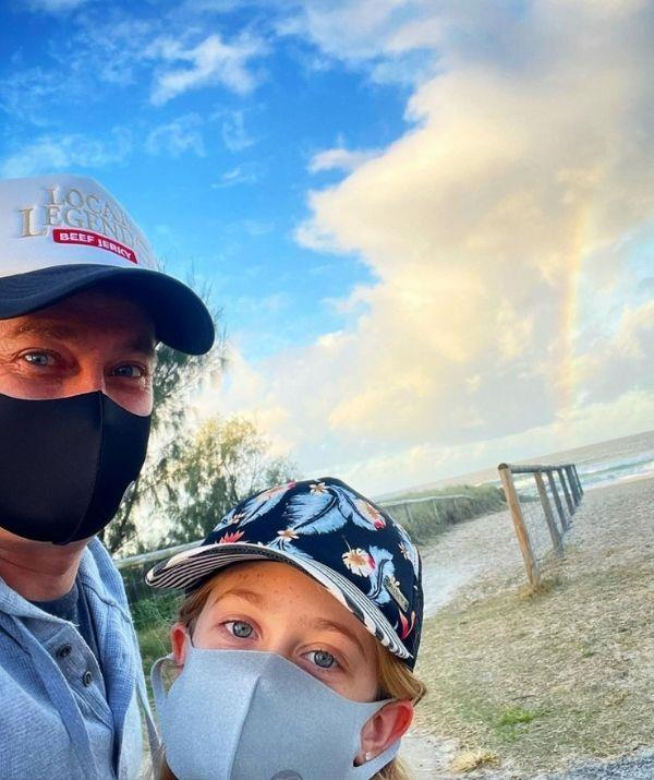 """**Grant Denyer**  <br><br> Grant is embracing his daily lockdown walk with his daughter for some fresh air. <br><br> The presenter captioned the picture, """"There's always hope. And gorgeous arvo walks to keep my killer rainbow content up 🌈."""""""