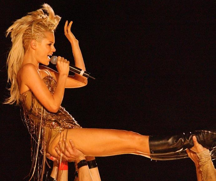 The higher the hair: Sophie rocked this eye-catching mohawk during her performance at the 2002 grand final pre-match.