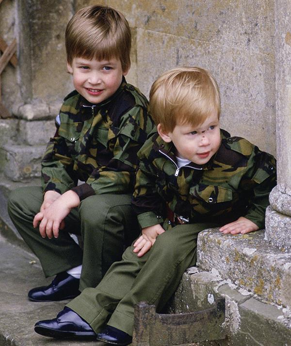 Even as small children, Harry and William shared a unique relationship defined by their status as royals. Grandsons to a queen and sons to a future king, the boys were destined for futures in a monarchy much bigger than them - but that didn't matter when they were kids. Here the princes look like any set of brothers playing together in their matching military outfits.