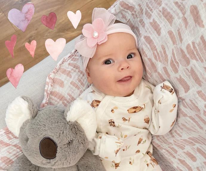 """Grace has got the giggles! Chandler shared this photo of his little girl with the sweetest baby update. """"Our happy girl! Grace has started giggling all the time and loves spending her afternoons walking through the zoo with us. She especially enjoys the flower gardens just like her mum,"""" he wrote."""