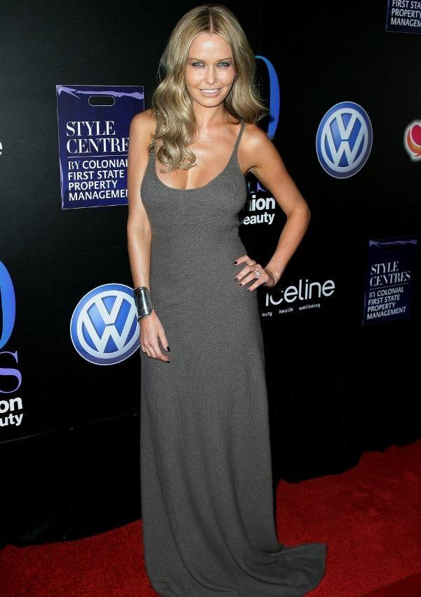 **Lara Worthington, 2008** <br><br> In the later end of the 2000s, Lara Worthington (then Bingle) was Australia's biggest It Girl. This figure-hugging, low-cut round neckline maxi dress was a classy take on the maxi trend that usually featured bold patterns.