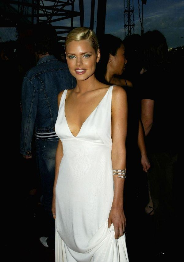 **Sophie Monk, 2003** <br><br> Sophie looked so fresh in this silk white low cut cress to the 17th Annual Aria Awards. Straight line dresses were a big look in the 2000s, and they had the most ethereal effect.