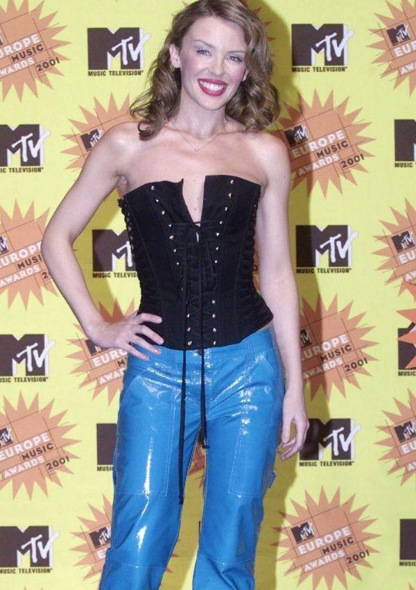 **Kylie Minogue, 2001** <br><br> Kylie wearing a corset with shiny electric blue wide-legged plants is simply iconic, and it's likely young girls everywhere would love to get their hands on a dupe.
