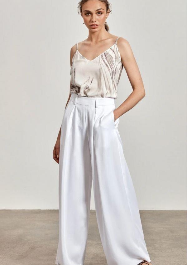 """'Lena' Wide-Leg Pant, White, $245 by Maara Collective can be [found here.](https://shop.maaracollective.com/collections/clothing/products/lena-resort-pant-with-lace-trim