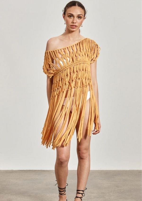 """'Ella' Woven Tunic, Ochre Yellow, $149.00 by Maara Collective can be [found here.](https://shop.maaracollective.com/collections/clothing/products/ella-woven-tunic-with-beads-4