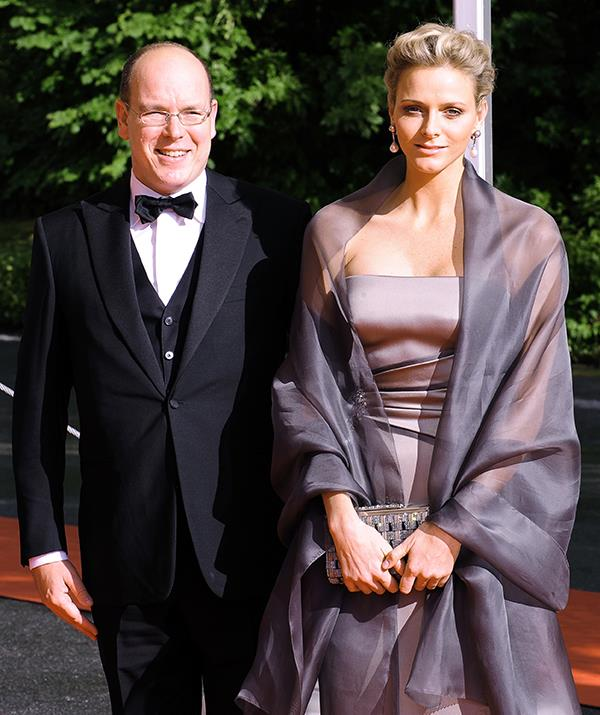 Princess Charlene attending an event with Prince Albert in 2010, a year before they tied the knot.