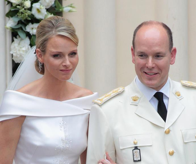 Other photos from their wedding day showed Charlene looking downcast and uncomfortable.