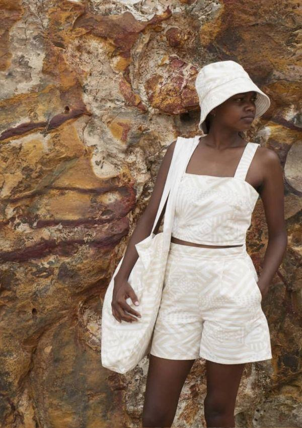 **Bima Wear**  <br><br> This brand dates back to 1969 when Sister Eucharia and Tiwi women created the company, with some still working today. Bima designs, prints, and manufactures their creations, which seek to share their culture and distinct language.