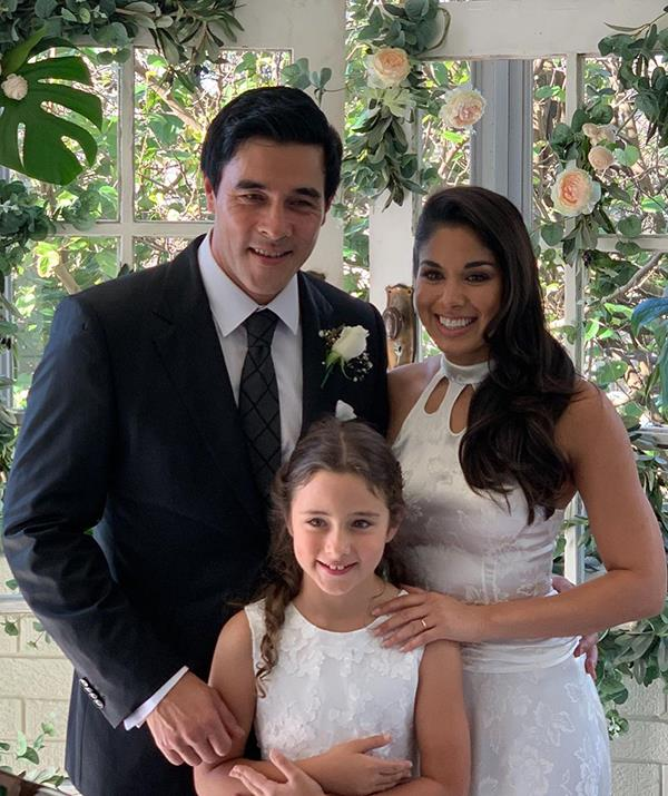 James Stewart and Sarah Roberts with James' daughter Scout on their wedding day in Australia.