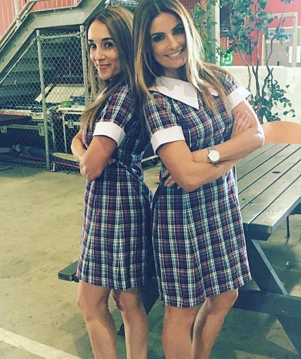 Laura and Ada Nicodemou put on their old Summer Bay school dresses for a snap.