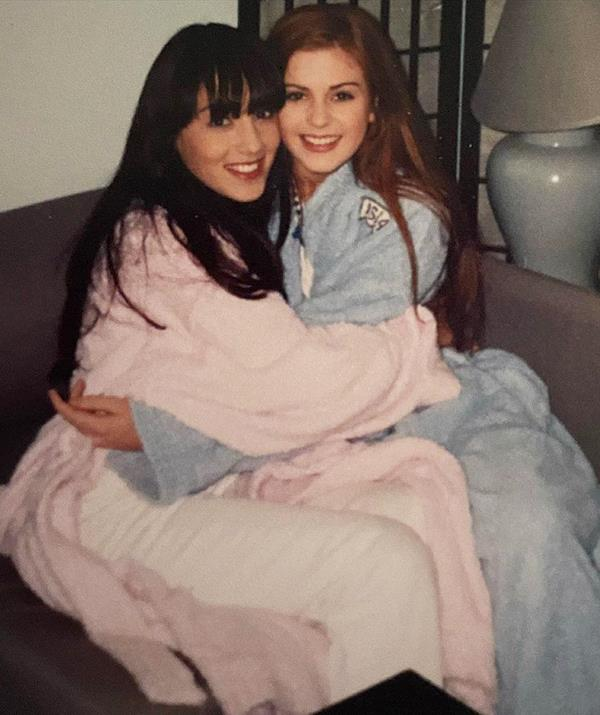 Laura shared this throwback snap with Isla Fisher.