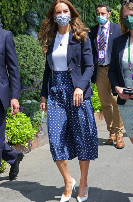 Kate wore a beautiful gold-buttoned blazer just last week.