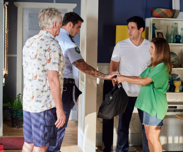 With John and Justin on hand, Leah reluctantly turns in the bag of recovered money to cop Cash.