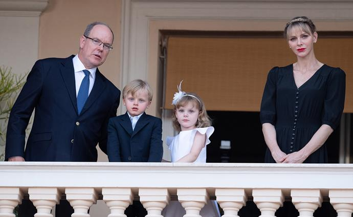 Princess Charlene stands with her husband and children in 2020.