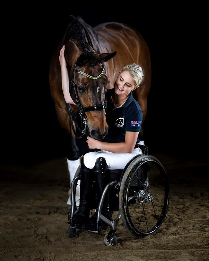 """**EMMA BOOTH** <br><br> *""""I wouldn't change a thing.""""* <br><br> Emma Booth knows better than most the courage it takes to get back on the horse. In 2013, the budding equestrian was involved in a near-fatal car accident that left her with paraplegia, a fractured skull, a punctured lung, a fractured sternum, severe abdominal injuries, a broken ankle and serious internal bleeding.  <br><br> Despite this, she never questioned whether she would get back in the saddle – only when. After six months of physiotherapy and rehabilitation, she finally got the sign-off from doctors. <br><br> """"When I got back in the saddle, there was no fear, only excitement,"""" Emma tells *The Weekly*. """"I had been waiting for that moment for six months. It was hugely motivating after a really traumatic and tragic event."""" <br><br> Almost immediately, Emma began training for the 2016 Rio Paralympics, where she placed fifth in dressage. Two years later, at the 2018 World Equestrian Games in the US, she finished fourth. In Tokyo, accompanied by her loyal sidekick, a Danish Warmblood named Zidane, Emma hopes to go one better. <br><br> """"I am competitive by nature,"""" she admits. """"Of course I am excited just to be a part of the Games but I want to do the best performance I can."""" <br><br> Emma, who recently turned 30, has been obsessed by horses since childhood. Her family wasn't at all """"horsey"""" so when Emma begged for a pony, her parents assumed it was a passing phase.  <br><br> """"But I never stopped asking,"""" she admits. Aged 11, Emma entered a competition on the television show, The Saddle Club, winning a horse for 12 months, as well as a year's worth of horse riding lessons. She was hooked. Within three months, she had started competing in small events, and had begun to dream of one day representing her country. <br><br> Her love of riding took her to Germany in 2011, where she rode and trained horses for international dressage rider Holger Schulze. After returning to Australia, she continued with the spo"""