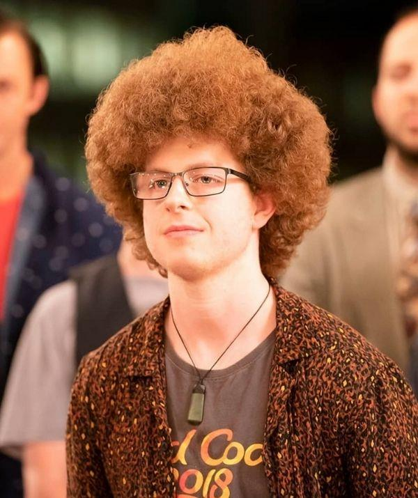 Sam's iconic afro got some extra love and looked as lush as it possibly could. Also, notice how his outfit matched his red hair wonderfully.