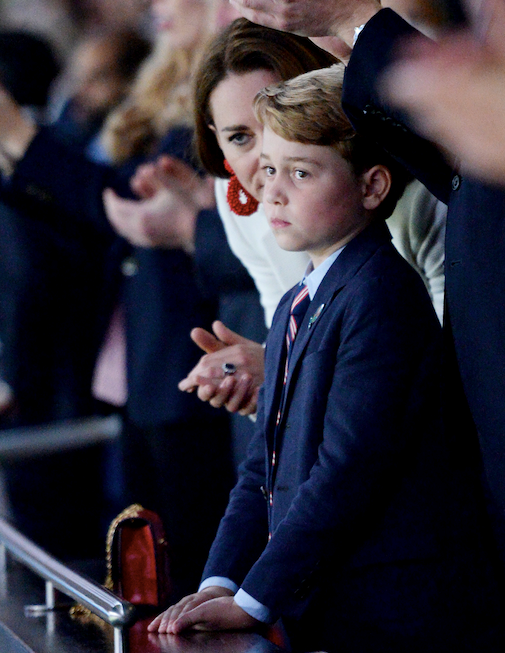 Kate attended the game with son Prince George and husband Prince William - spot her chic red Mulberry bag.