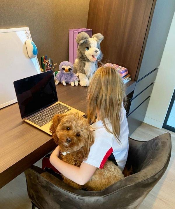 """**Sonia Kruger** <br><br> Sonia's daughter Maggie is pictured with her swanky homeschool set up, and to keep her company, she is accompanied by some plush toys and her cavoodle called Teddy. <br><br> The *Big Brother* host captioned the post, """"Home school is in! Let's do this 🤓📚✍️ #homeschool."""""""