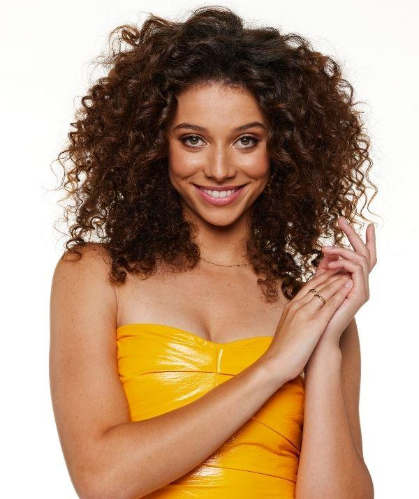 **Gabrielle - as seen on Beauty and the Geek** <br><br> For her promo shot, Gabrielle wore a yellow strapless dress.