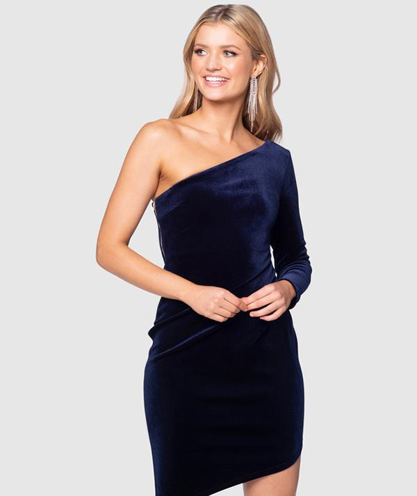 """The Aasta Midi by Pilgrim is a similar navy velvet frock with an asymmetrical cut. [Shop it here for $179.95.](https://www.theiconic.com.au/aasta-midi-1279127.html target=""""_blank"""" rel=""""nofollow"""")"""