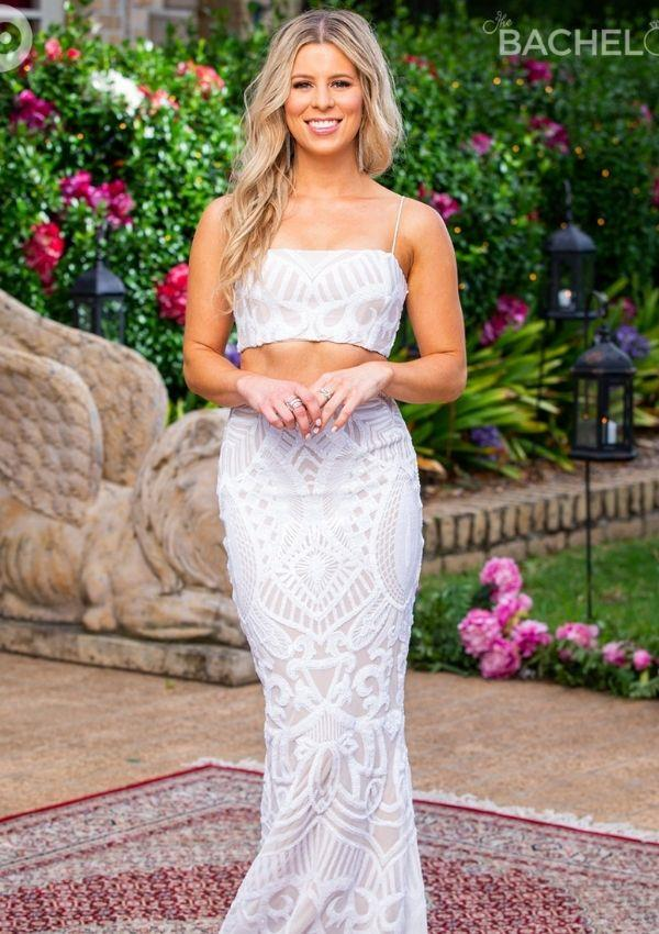 White outfits were very on-trend during the show's second rose ceremony. Ashleigh wore this crop top and maxi skirt set with textured patterns that added dimension to the design. She opted for silver accessories and loose waves to style her look.