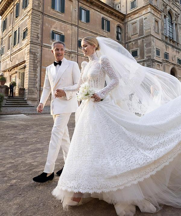 Her classic bridal gown featured long sleeves, a structured bodice and high neckline, with lace covering her from head to toe. It bore a striking resemblance to Duchess Catherine's own lace wedding dress, and had small puff sleeves reminiscent of the more over-the-top ones on Princess Diana's wedding gown. Lady Kitty was also inspired by her own mother, Victoria Aitken, and drew on design elements from her wedding dress from 1989.