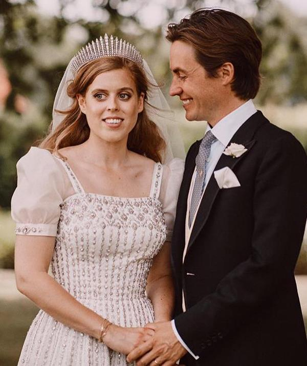Featuring organza sleeves and encrusted with diamantés, the dress was remodelled and fitted by one of the Queen's favourite designers, Miss Angela Kelly as well as Mr Stewart Parvin especially for Beatrice's wedding day. Beatrice also borrowed a tiara from the Queen for her wedding day, donning the Queen Mary diamond fringe tiara, which Her Majesty wore on her own wedding day to Prince Philip in 1947.