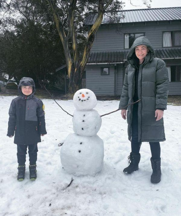 The mother-son duo got creative in the snow and made a snowman together during a winter weekend together. By the look of their big smiles, they were pretty proud.