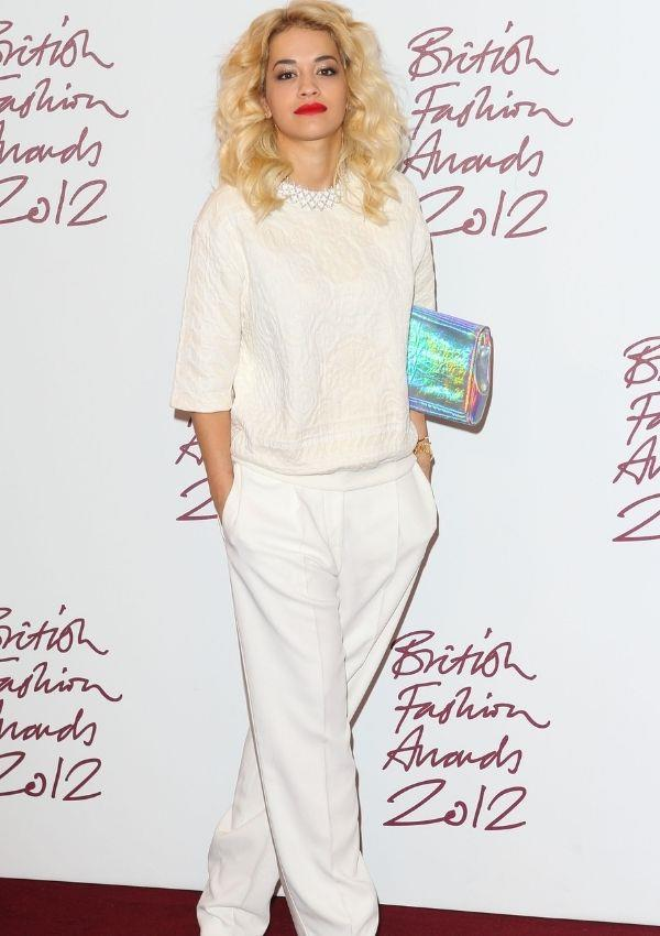 **British Fashion Awards, 2012** <br><br> Even at the start of her career, Rita was showing off some incredible fashion moments. This monochromatic pant and pearl-adorned jumper fit in with the high fashion athleisure moment that was gaining traction at the time.