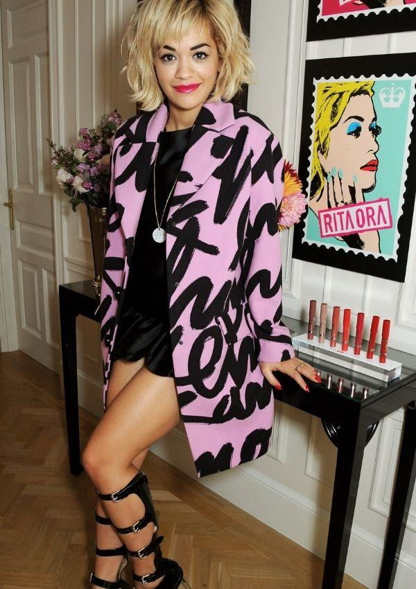**Rimmel London: 180 Years of Cool, 2013** <br><br> Rita wore this incredible pink graphic coat with the most fabulous hybrid mary jane x boot shoes.