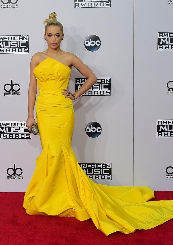 **American Music Awards, 2014** <br><br> Rita wore this canary yellow Zac Posen dress to the awards, and her mermaid train was 2014's biggest red carpet trend.