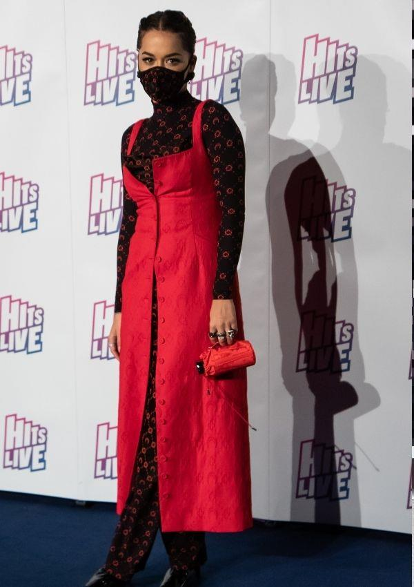 **Hits Radio Live Birmingham, 2019** <br><br> Rita wore this Covid safe outfit just before the pandemic really took off. The red and black look is way cooler than we feel in our masks.
