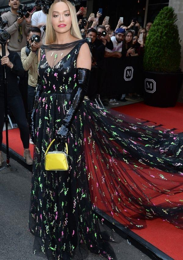 **Met Gala, 2018** <br><br> Rita wore Prada to the biggest fashion event of the year. The tulle adorned gown was a more subtle take on her fashion taste, but the green and pink accents call to her eccentric proclivities.