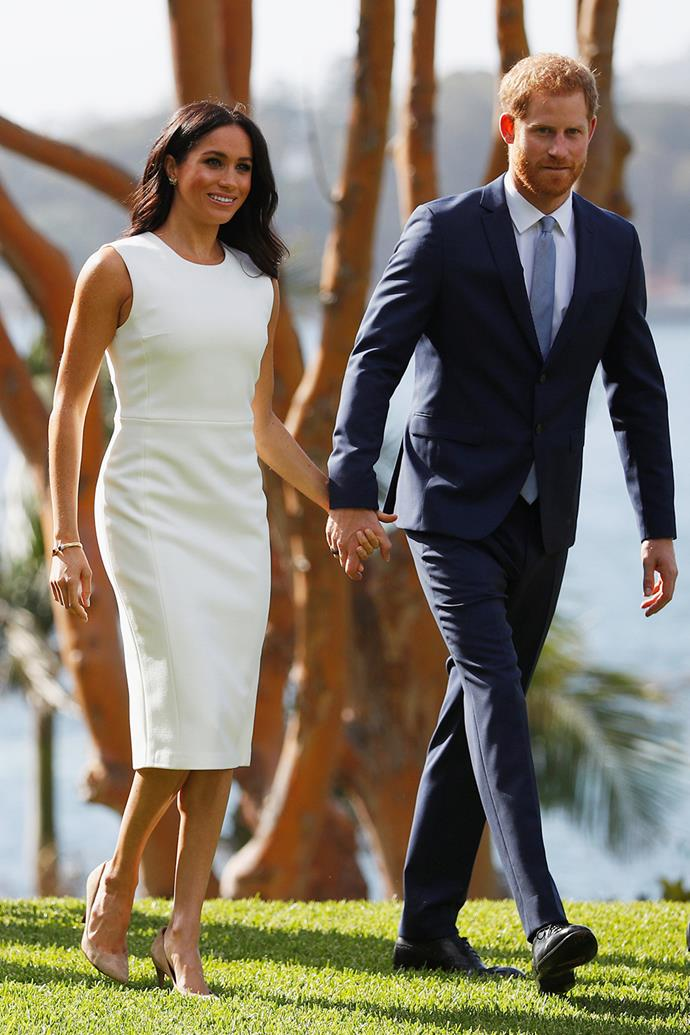 This $1,800 Karen gee dress sold out in minutes when Duchess Meghan wore it in Sydney just hours after she and Prince Harry announced they were expecting their first child. Pictured here at Admiralty House on October, 2018, the chic white frock proves that less really can be more.