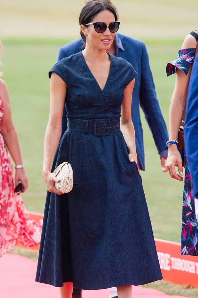 Belted midi styles are great for highlighting your waist, something the Duchess of Sussex knows well. She donned this denim Carolina Herrera midi with a wrap neckline for the Sentebale ISPS Handa Polo Cup in July 2018 for an effortlessly cool look.