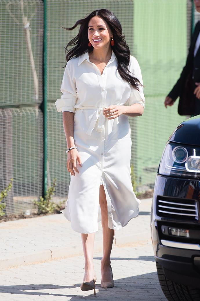 Duchess Meghan pulled out several midi styles while she and Prince Harry were on their tour of Africa in late 2019, including this flowing white Hannah Lavery dress. She wore it during a visit to the Tembisa Township, opting for a relaxed look with her hair hanging in loose waves.