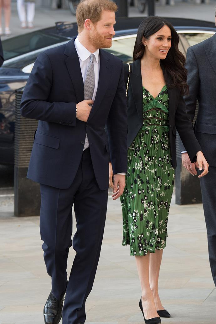 """When she joined the royal family in 2018, Duchess Meghan gave up some of her old faithful fashion staples - [including mini skirts and dresses](https://www.nowtolove.com.au/fashion/fashion-trends/meghan-markle-young-63319 target=""""_blank"""") - to develop a more refined and modest style. Midi dresses played a big role in that shift, as they're chic and on-trend while still fitting to royal fashion rules. This patterned green Self-Portrait frock she wore in April 2018 for an Invictus Games Reception at Australia House is a perfect example, paired with a tailored blazer."""