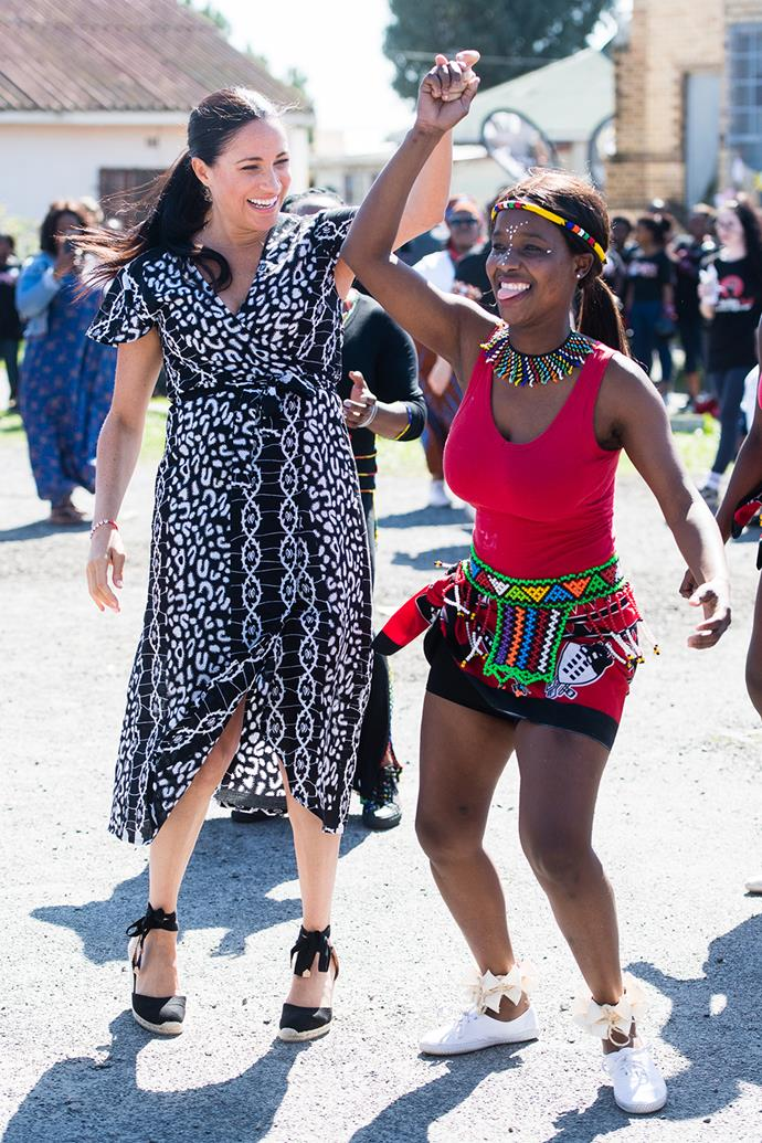 One of the benefits of a wrap midi like this Mayamiko frock is (as the Duchess so kindly showed us) you can dance in it! She twirled with locals from the township of Nyanga in Cape Town and took the world's breath away with her chic style, paired with her favourite wrap-around espadrilles.