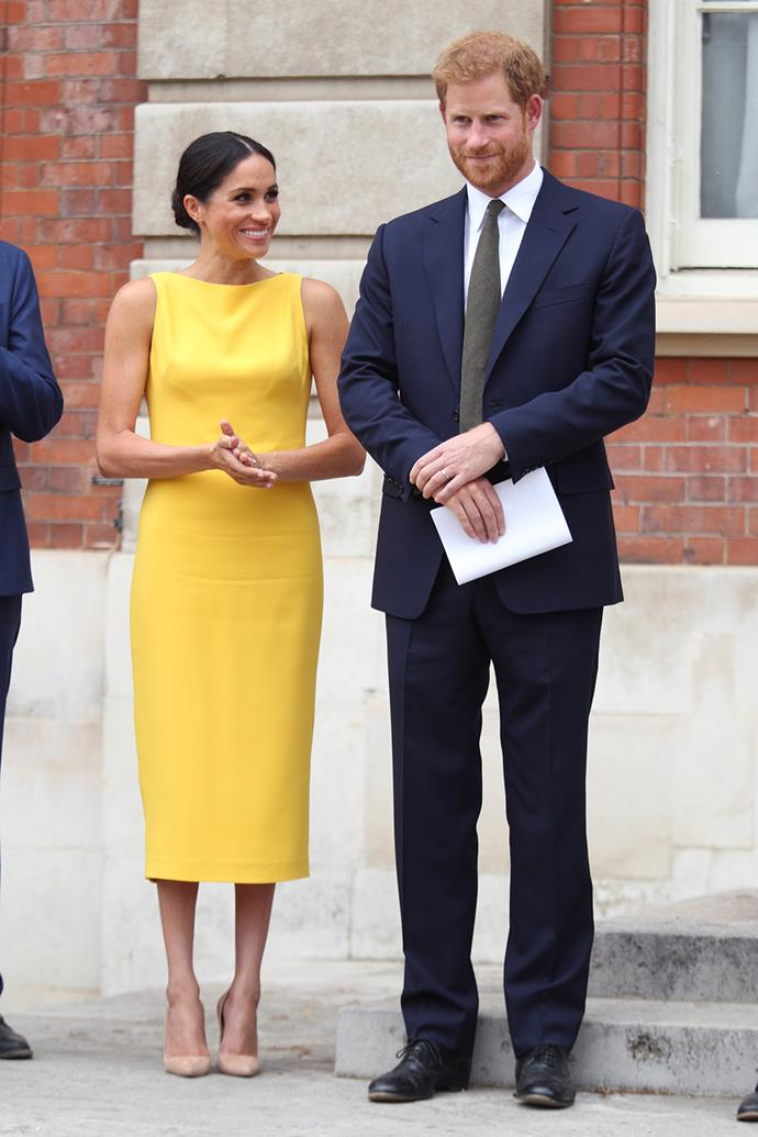 Tailored dresses became a new staple for the Duchess, with bright pops of colour like this yellow Brandon Maxwell frock from July 2018 making regular appearances. She wore the $2,020 midi for the Your Commonwealth Youth Challenge reception at Marlborough House with Prince Harry, not long after their wedding.