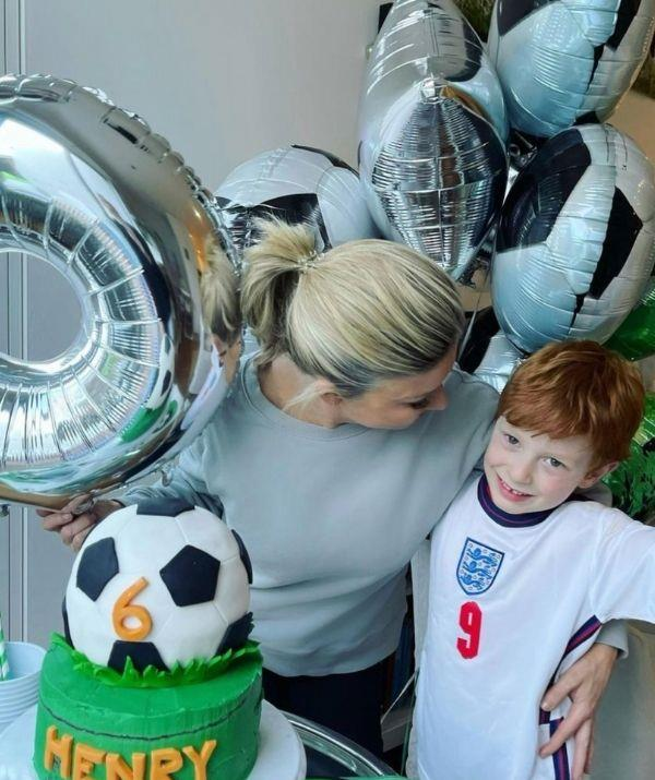 """Henry turned six during Sydney's 2021 lockdown but luckily his doting mother made sure he felt special, with a soccer themed cake and balloons.  <br><br> To commemorate the occasion Emily posted this message, """"Happy 6th birthday my beautiful boy 💙⚽️Look at his amazing cake (that has smarties inside!) made by our darling @lauren_e_hamilton 💜 A lockdown birthday that was made so special by his school teachers, little friends, Mums sending videos, FaceTime chats with cousins and beautiful family and even happy birthday sung to him by Aunty Lally and family from the front garden! So much love and kindness 🎈."""""""