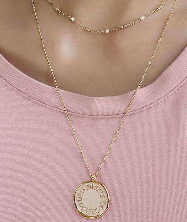 "Wanderlust + Co Zodiac Ivory Enamel Gold Necklace $81 - [shop it here.](https://www.theiconic.com.au/zodiac-ivory-enamel-gold-necklace-1296465.html target=""_blank"" rel=""nofollow"")"