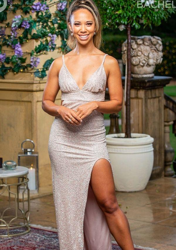 Ash-lee wowed in this low hanging dress with side cut-outs and a sexy side slit. Her beauty look calls to Ariana Grande's iconic high ponytail – which suits this bachelorette so well.
